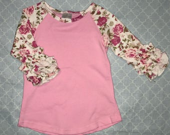 Childs pink flower ruffle sleeve raglan. Comes in s-xxl S=-2t, m=3-4t, L=4-5t....Available plain or custom with design of your choice.