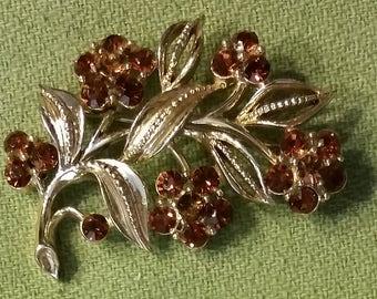 Lisner Flower Brooch with brown rhinestones