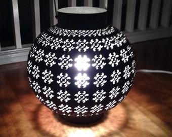 Intricately punched metal lantern
