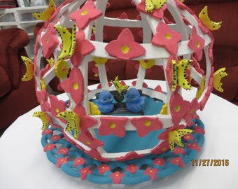 Pink bird cage with butterflies