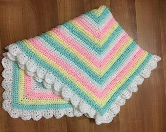 Crocheted sparky pastel stripped pram/baby blanket
