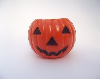 Vintage Halloween hard plastic Jack O Lantern orange pumpkin candy container
