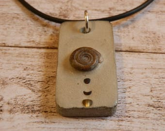 Concrete snail pendant