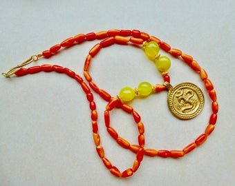 "Coral necklace with jade ""Aum"""