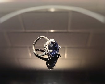 Silver ring with blue gemstone.