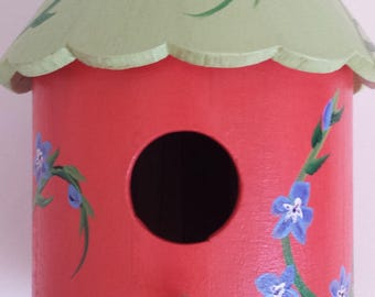 Birdhouse with periwinkles