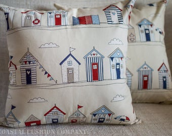 "Beach Huts Blue Nautical Seaside Cushion Cover. Red and blue seaside coastal beach huts. 17"" x 17"" Square, 100% cotton."