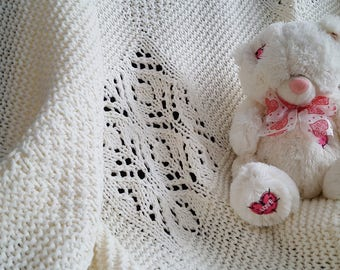 Cream-coloured knitted baby blanket