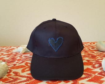 Cap blue with a knitted heart