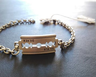 Fully bracelet in sterling silver with a razor blade.