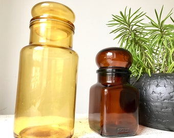 Two vintage pharmaceutical jars / yellow and brown glass / bubble lid in glass / storage pots / 1950s