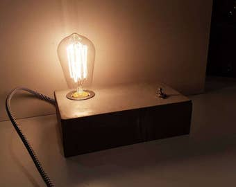 Concrete brick lamp with Edison bulb