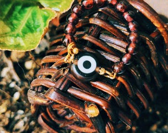 The Guardian Eye   pinkie ring,  4mm garnet beads, evil eye protection