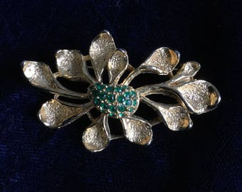 Vintage gold tone and green paste brooch