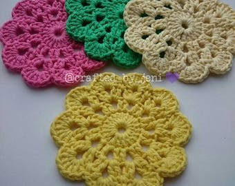 100% cotton crocheted flower drinks coasters/mats x4. Handmade. Protection. Multi-coloured. Yellow. Cream. Green. Pink. 12cm-13cm diameter.