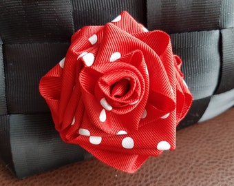 Red and white polkadot rosette for Harveys bag