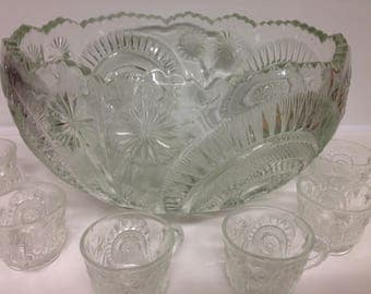 Vintage cut glass bowl with 18 cups.  Horseshoe daisies designs.