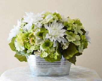 Pretty green and white silk flowers in galvanized container