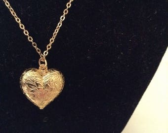 Gold Heart pendant with floral detail