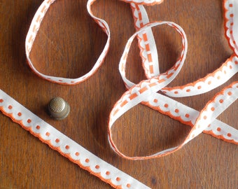 Scalloped cotton edge ribbon with embroidered dots in orange over white 12mm width - Sold by the meter