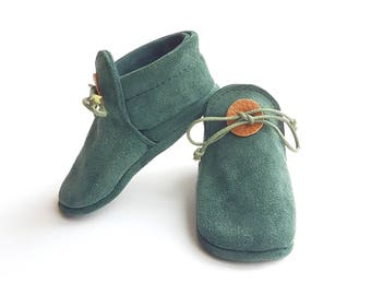 Baby moccasins dark turquoise.