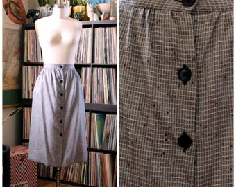 "1980s does 50s skirt . silver gray checked skirt . mid length secretary skirt, button front 29"" waist, womens size medium large"