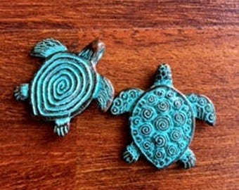 Brass turtle pendants with turquoise blue patina - two pieces