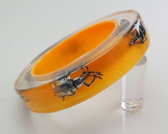 Huge yellow lucite bangle with real exotic insects