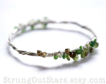 Lucky - Strung-Out Guitar String Bangle with green gemstones