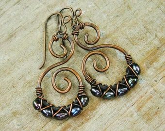 Hammered Copper Swirls with dark iris freshwater pearls criss cross wire wrapped in antiqued copper dangle earrings