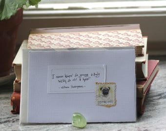 I never knew so young a body with so old a head Pale card with handwritten quote and Swedish postal stamp with pug