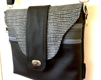 Cross body zipper vegan bag in night snow fabric flap.