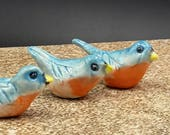 three miniature bluebirds -  porcelain sculpture