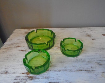 Three heavy vintage / retro / midcentury green glass ash trays 1 large 2 small