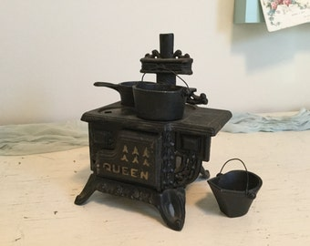 Antique Cast Iron Queen Stove with Pan, Caldron, and Coal Shuttle