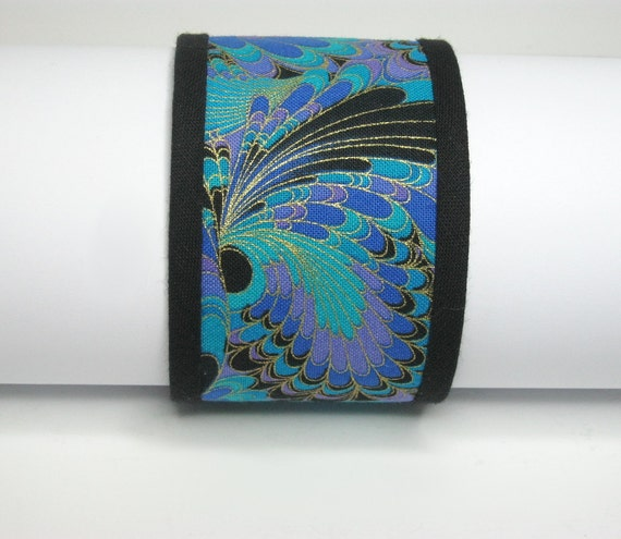 FABRIC CUFF BRACELET: In 'butterfly wings' fabric. Medium to large. Hand sewn.