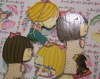 four little wooden cutouts