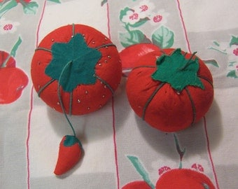 two little red vintage pin cushions