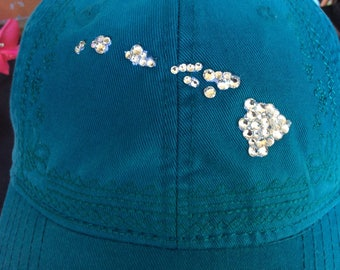 Baseball style teal-colored island chain hat embellished with Swarovski crystals
