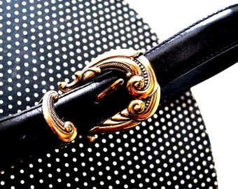 Victorian style vintage 80s black genuine leather belt with a ornate brass buckle, end cup and bar. Made by talbots.Size large.