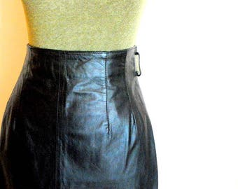 Classy  vintage 90s black  genuine leather , pencil style skirt. Made by Wilsons leather. Size 12.