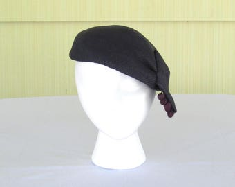 Vintage 1950's navy blue straw beret with pom pons