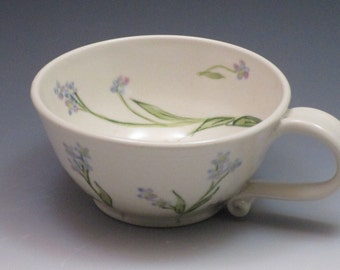 Porcelain teacup handthrown and handpainted in forget me not flowers