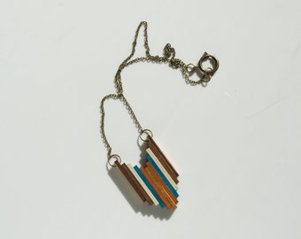 Santana Wooden Pendant Necklace in Gold, Orange, Teal, Cream, Bronze and Natural Wood
