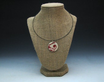 Red and White Ceramic Pendant with Swirl Pattern