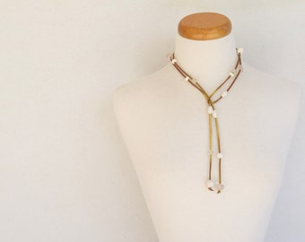Resin bead lariat necklace crisp solid and frost white assorted shaped resin beads spaced along gold suede cord can be worn as a belt too
