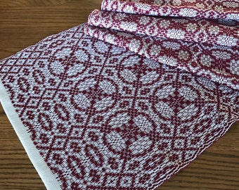 Handwoven overshot table runner in garnet red. Whig Rose pattern.