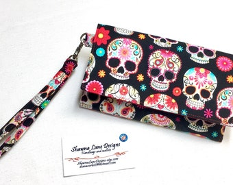 women's wallet, wristlet with strap, novelty sugar skulls, black and colorful wallet, small purse, errand runner, cell phone accessory