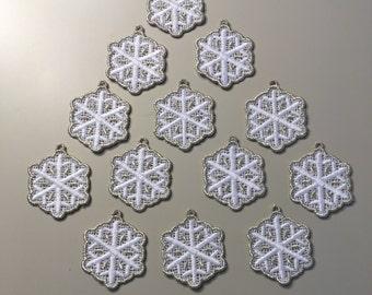 One dozen silver trimmed mini snowflakes