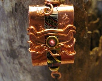 Tibetan inspired  prayer package pendant copper and tin with OM inside